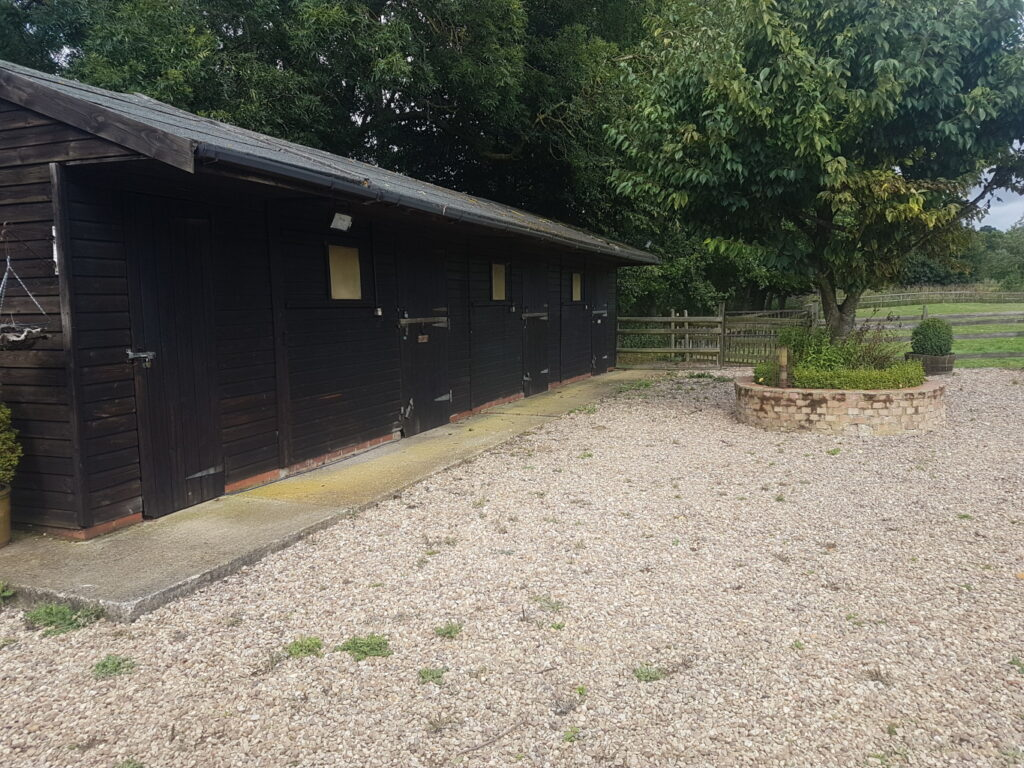 Gravel area outside stables.