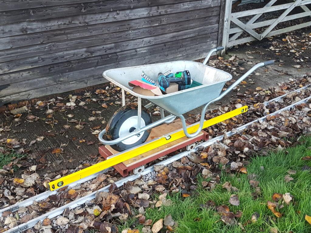 Tea tray with wheelbarrow.